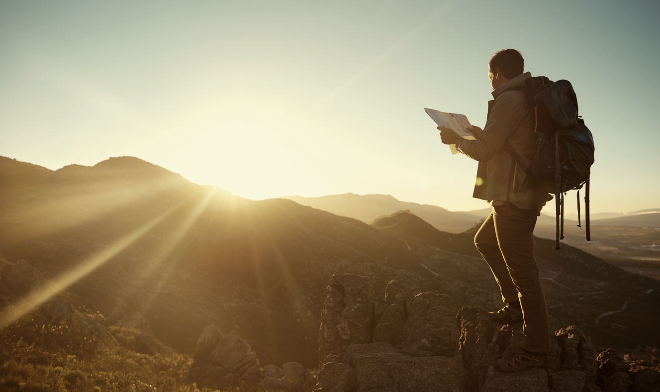 Shot of a young hiker holding a map while taking in the view from the top of a mountainhttp://195.154.178.81/DATA/i_collage/pu/shoots/804697.jpg