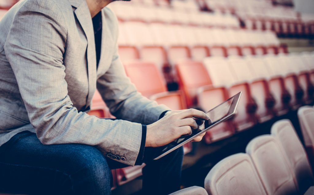 Footbal manager on the stands and lists
